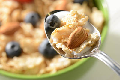 Bowl Of Cereal With Bluberries And Almonds On Spoon Poster