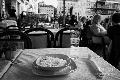 Bowl Of Spagetti Carbonara And Glass Of Beer Sitting On A Table In A Street Cafe In The Piazza Navona Rome Lazio Italy Poster by Joe Fox