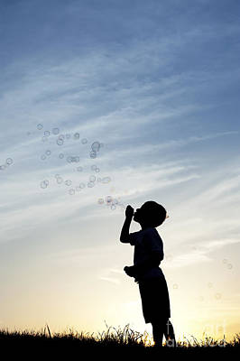Boy Blowing Bubbles Poster