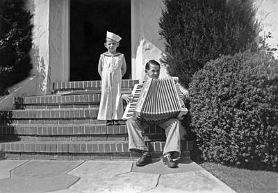 Boy Playing Accordian On Steps Poster by Underwood Archives
