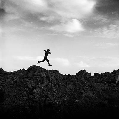 Boy Running Over Dirt Pile Poster by Donald  Erickson
