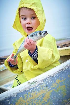 Boy Wearing Raincoat Holding A Mackerel Poster by Ruth Jenkinson
