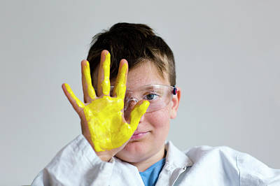 Boy With Yellow Paint On Hand Poster