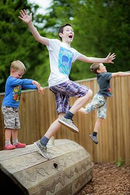 Boys Playing In Park Poster