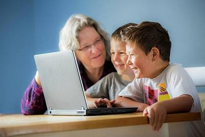 Boys Using Laptop With Grandmother Poster by Samuel Ashfield