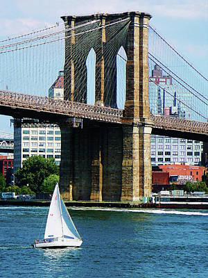 Bridge - Sailboat By The Brooklyn Bridge Poster by Susan Savad