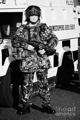 British Army Soldier With Mp5 On Crumlin Road At Ardoyne Shops Belfast 12th July Poster by Joe Fox