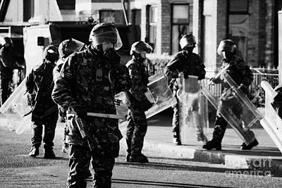 British Army Soldiers In Riot Gear On Crumlin Road At Ardoyne Shops Belfast 12th July Poster by Joe Fox