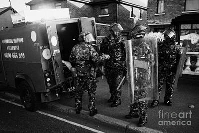 British Army Soldiers In Riot Gear Pack Up On Crumlin Road At Ardoyne Shops Belfast 12th July Poster by Joe Fox