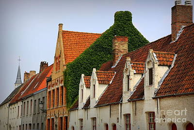 Bruges Rooftops Poster by Carol Groenen