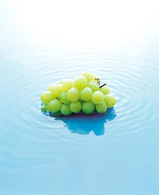 Bunch Of Grapes Floating On Water Poster