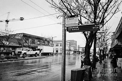 bus stop on main street heading downtown from mount pleasant on a wet day Vancouver BC Canada Poster