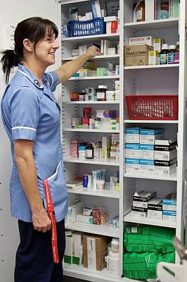 Cancer Nurse Retrieving Drugs Poster by Life In View