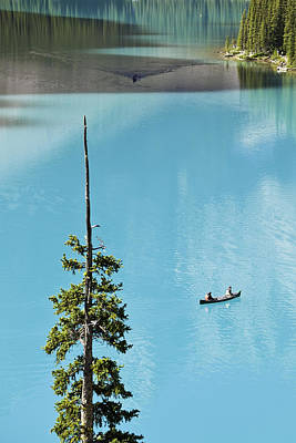 Canoeing On Turquoise Water Of Moraine Poster by Ken Gillespie
