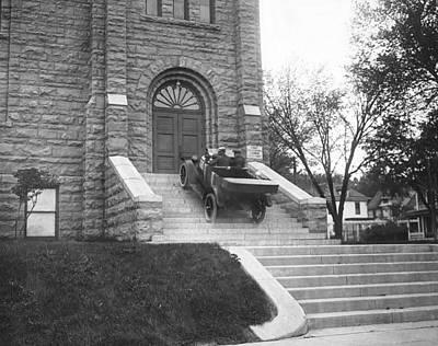 Car Climbs Church Steps Poster