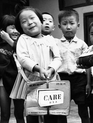 Care Package Brings Smile Poster by Underwood Archives