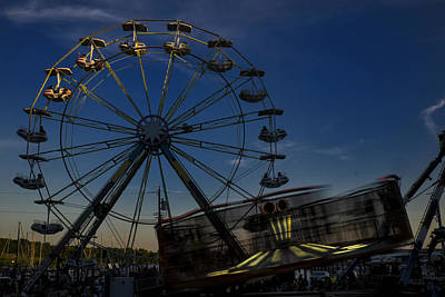 Ferris Wheel And Carnival Rides At Dusk Poster