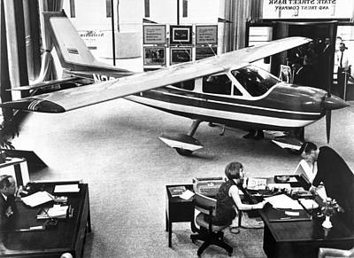 Cessna In A Bank Poster by Underwood Archives