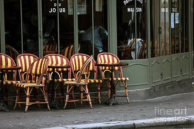 Chaises De Cafe Poster by John Rizzuto