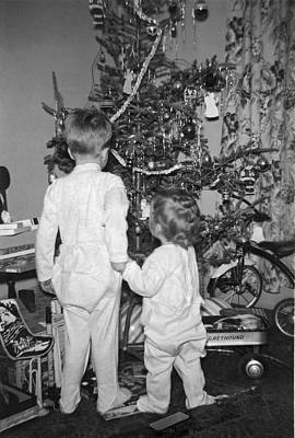 Children Check Christmas Tree Poster by Underwood Archives