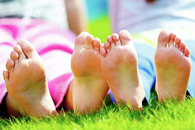 Children Sitting On Grass With Bare Feet Poster