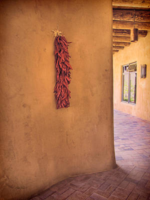Chili Peppers On Adobe Wall Poster by Ann Powell