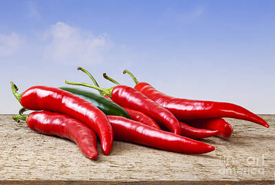 Chilli Peppers On Rustic Background Poster by Colin and Linda McKie