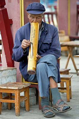 Chinese Man Smoking A Water Pipe. Poster by Tony Camacho
