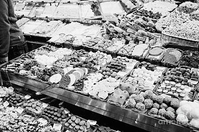 chocolates on display inside the la boqueria market in Barcelona Catalonia Spain Poster