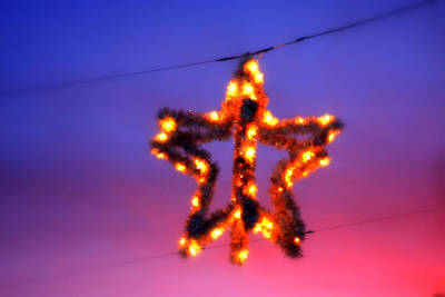 Poster featuring the photograph Christmas Star by Aurelio Zucco