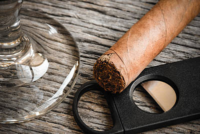 Cigar And Cutter With Glass Of Brandy Or Whiskey On Wooden Backg Poster