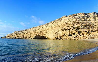 Cliffs At Matala On Crete Poster by Paul Cowan