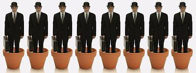 Clones Of Man In Business Suit Standing Poster by Darren Greenwood