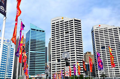 Colorful Flags Lead To City By Kaye Menner Poster by Kaye Menner