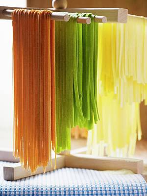 Coloured Pasta Hanging Up To Dry Poster