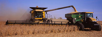 Combine Harvesting Soybeans In A Field Poster by Panoramic Images