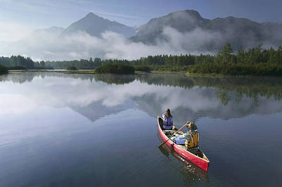Couple Canoeing On Lake Portage Valley Poster by Michael DeYoung