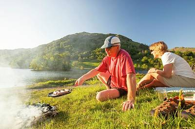 Couple Enjoying A Barbeque Poster by Ashley Cooper