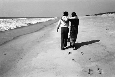Couple Walking On Beach Poster