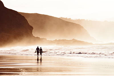 Couple Walking On Beach With Fog Poster by Mikel Martinez de Osaba