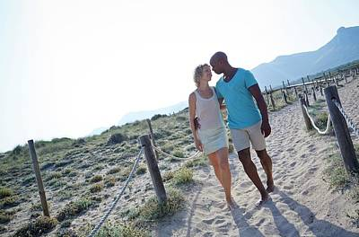 Couple Walking On Sand On Holiday Poster