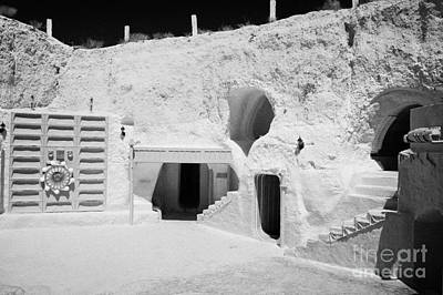 courtyard and steps leading to caves of the Sidi Driss Hotel underground at Matmata Tunisia scene of Star Wars films with film props Poster