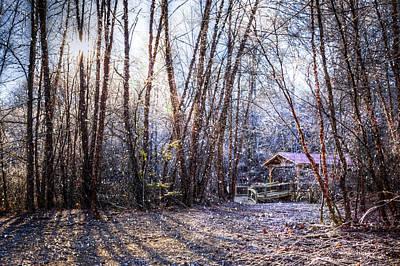 Covered Bridge In The Winter Poster by Debra and Dave Vanderlaan