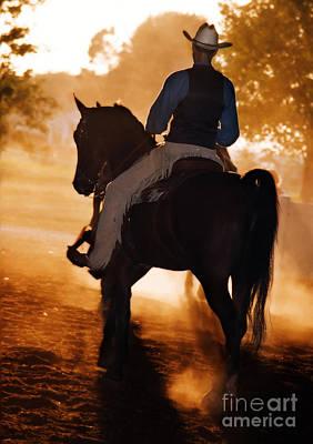 Cowboy In The Dust Poster by Leslie Heemsbergen