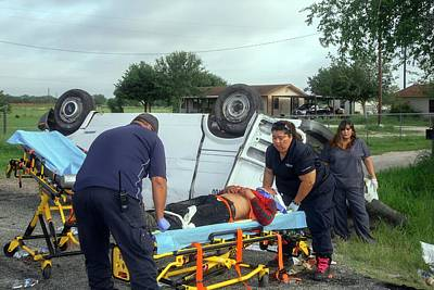 Crash Victim Being Treated Poster by Jim West