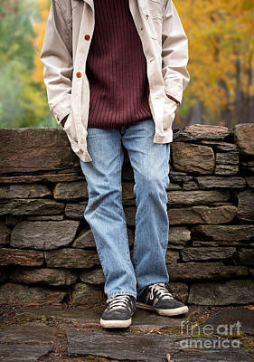 Cropped Man Standing Against A Stone Wall Poster