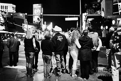 crowd of people standing waiting for crosswalk lights to change Las Vegas Nevada USA Poster