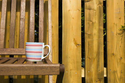 Cup On Garden Chair Poster