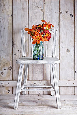Daylillies On A White Chair Poster by Edward Fielding
