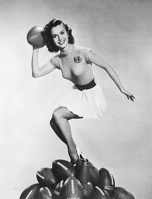 Debbie Reynolds Throws A Pass Poster by Underwood Archives